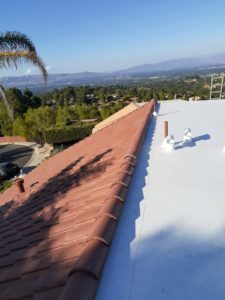 Tile and flat roof installed in 2020 by Modern Roofing